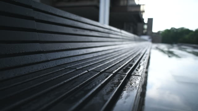 empty wet bench in the park - bench stock videos & royalty-free footage