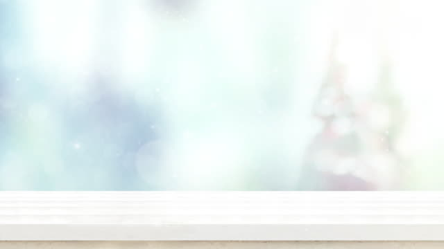 empty white wood table top and snow falling with blur christmas tree bokeh light background,backdrop template for display of product or design,food stand mock up - kitchen worktop stock videos and b-roll footage