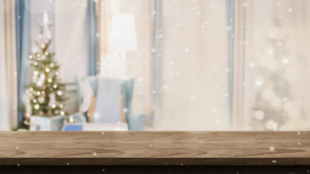 empty white wood table top and snow falling with blur christmas tree bokeh light background,backdrop template for display of product or design,food stand mock up - template stock videos and b-roll footage