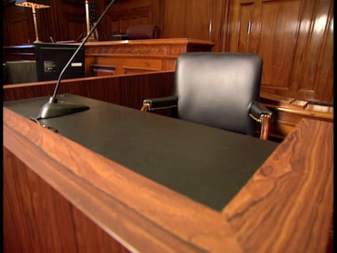 empty witness stand w/ chair & table microphone, empty judge's bench bg. testify, call witness, trial, law, truth, swearing oath, courthouse. - court room stock videos & royalty-free footage