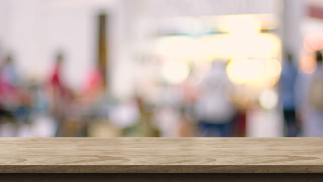 empty wood table top with blur customer shopping at trade event with bokeh light background,backdrop template for display of product or design,food stand mock up - tradeshow stock videos & royalty-free footage