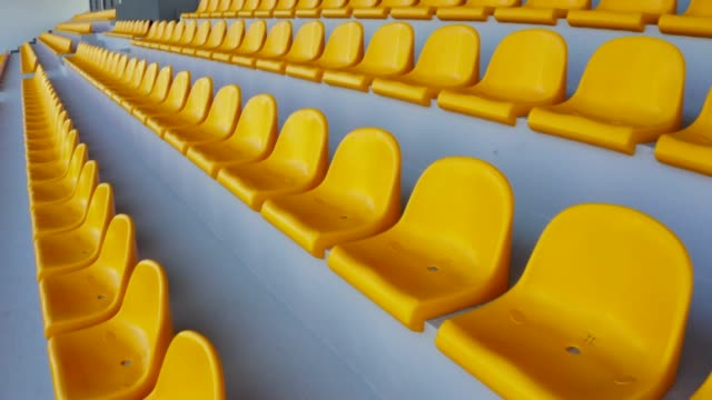 empty yellow seats in a stadium - chairs in a row stock videos & royalty-free footage