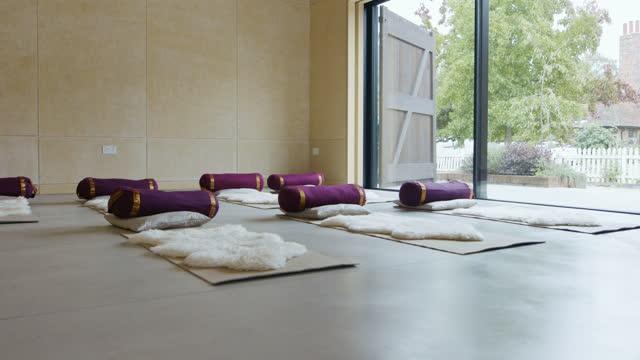 empty yoga studio with open door ready for class - doorway stock videos & royalty-free footage