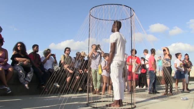 en ambas aceras de la avenida costanera del malecon por mas de un kilometro los cubanos van descubriendo obras de mas de 60 artistas de nueve paises - avenida stock videos & royalty-free footage