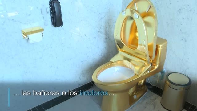 en el hotel dolce hanoi golden lake de vietnam el café es servido en una taza de oro los pisos son dorados y hasta el baño está recubierto de oro - taza de café stock videos & royalty-free footage