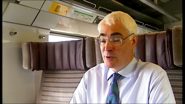 reporter seated with darling alistair darling mp interview sot no way we were going to underwrite the euro took until 2am to get that point accepted - alistair darling stock videos & royalty-free footage
