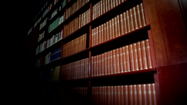 encyclopaedias in the library - library stock videos & royalty-free footage