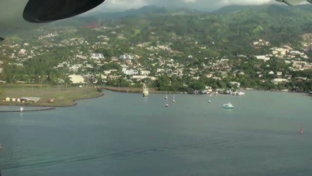 end of flight; landing on moorea island airport - moorea stock videos and b-roll footage