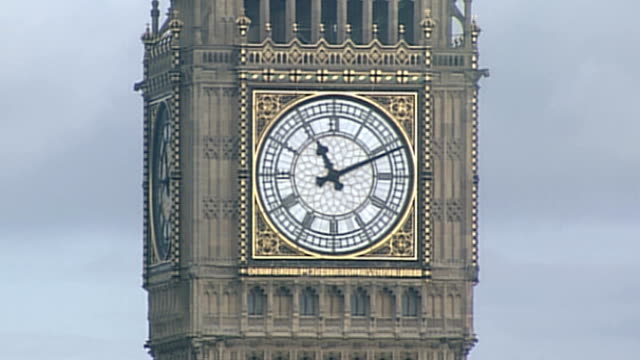 End of Mayan calendar cycle marked around the world ENGLAND London EXT Big Ben clock showing 1111am