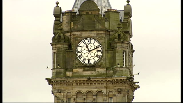 End of Mayan calendar cycle marked around the world SCOTLAND Edinburgh EXT Clock in Hunter Square showing 1111am GV Shoppers to and fro in street