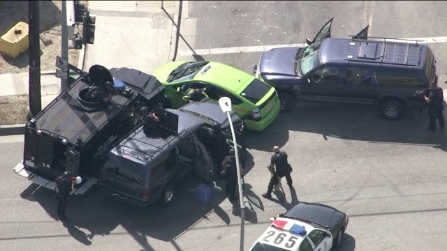 ktla end of pursuit in south los angeles on april 10 2015 grand theft auto suspect involved a bright green toyota prius taxicab the taxi sped up as... - 追いかける点の映像素材/bロール