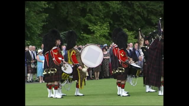 end of queen's golden jubilee tour balmoral garden party peter balmoral balmoral castle band plays outside balmoral castle sot gvs marching band... - golden jubilee stock videos & royalty-free footage