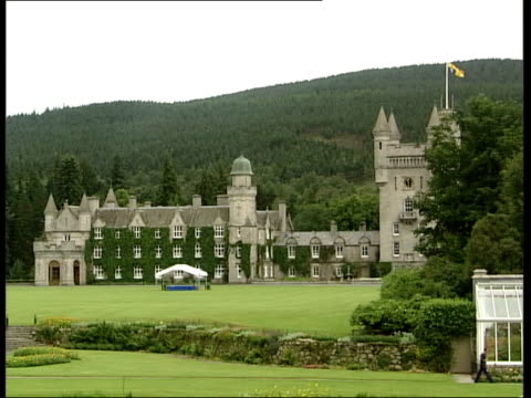 End of Queen's Golden Jubilee tour ITN Balmoral Balmoral Castle Groundstaff along Royal Standard flying from top of flagpole