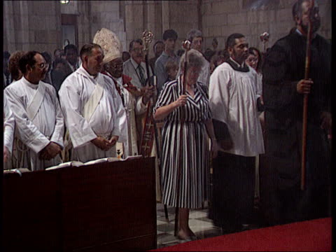 end of year report int ms multirace clergy down centre aisle followed by tutu as l - tutu stock videos & royalty-free footage