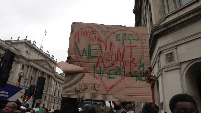 end sars protester in london due to nigerian police opened fire on protestors in lagos yesterday after 12 days of anti-police demonstrating.... - social justice concept stock videos & royalty-free footage