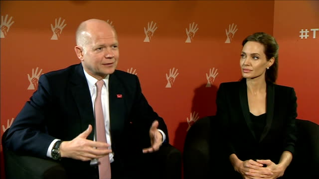 'end sexual violence in conflict' global summit in london: william hague and angelina jolie interview; england: london: westminster: int william... - victim stock videos & royalty-free footage