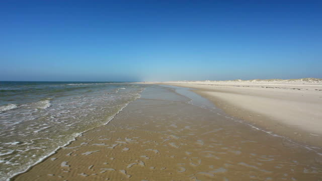 endless beach from amrum / germany - north sea stock videos & royalty-free footage