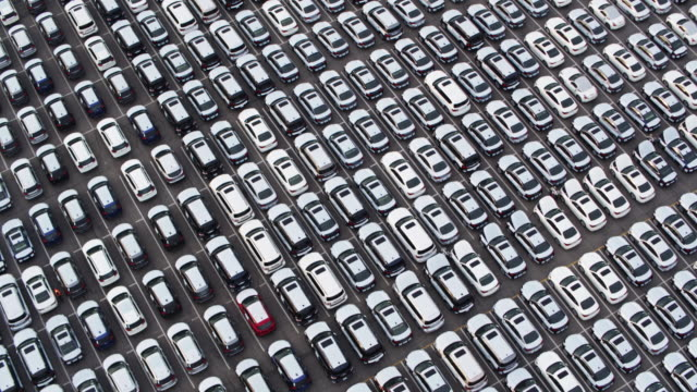 endless grid of new cars - drone shot - car park stock videos & royalty-free footage