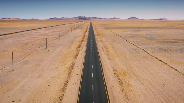 endless highway towards luderitz kolmanskop namibia aerial video - horizon over land stock videos & royalty-free footage
