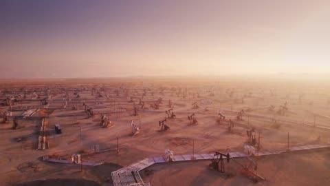 ändlösa oljefält - drone skott - oljepump bildbanksvideor och videomaterial från bakom kulisserna