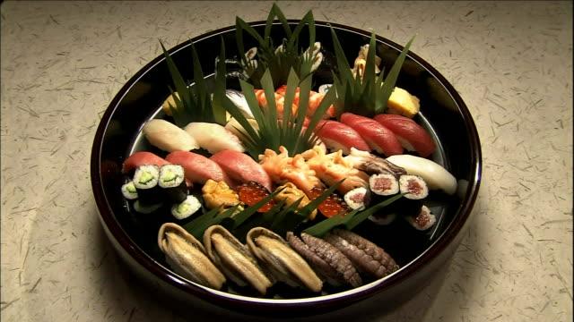 endomae sushi fills a black platter. - tray stock videos & royalty-free footage