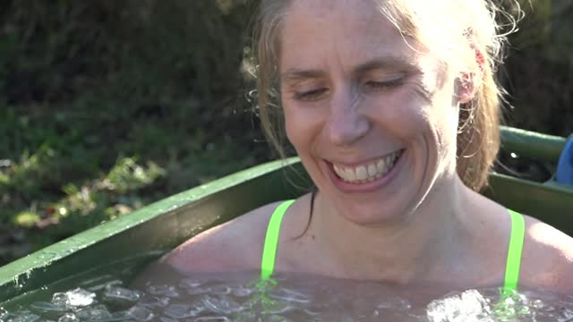 endurance swimmer prepares for cold waters of the north channel in back garden; england: surrey: ext long distance swimmer lucy ashdown-parkes... - endurance stock videos & royalty-free footage