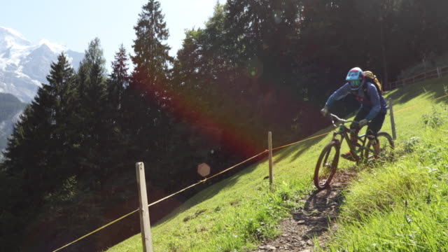 Enduro mountain biking on forest trail, 2 riders