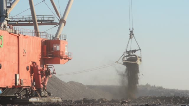 Enefit dragline excavators dig shale oil at Narva open pit mine in Narva Estonia on Wednesday Nov 19 gvs of the excavation digger shadow of the...