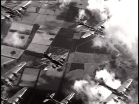 vídeos de stock, filmes e b-roll de aerial enemy fighter planes attacking massed bombers during wwii mission / germany - wehrmacht
