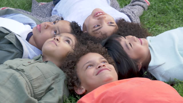 Energetic Group of Young Children Playing In Park