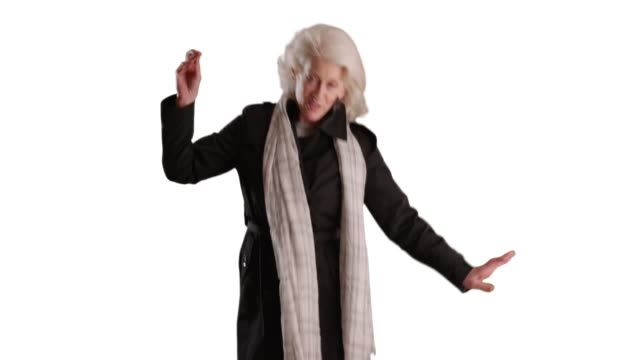 energetic senior woman dancing with scarf on white background smiling - weiß stock-videos und b-roll-filmmaterial