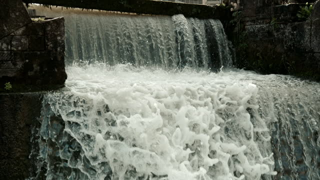 energetic water falls over a weir, uk - power supply stock videos & royalty-free footage