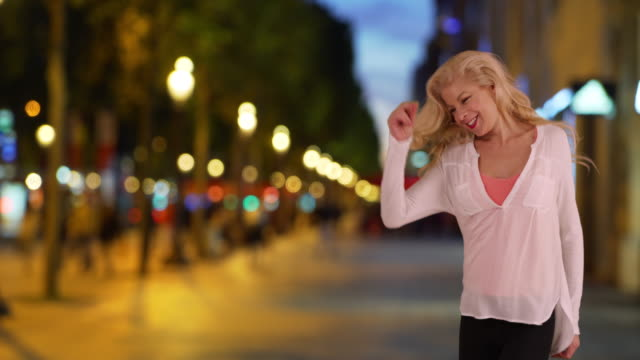 Energetic woman in the city having fun, dancing to her own beat