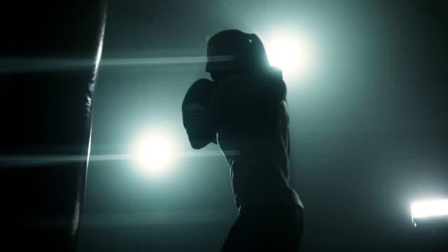 energetic woman kickboxing - back lit woman stock videos & royalty-free footage