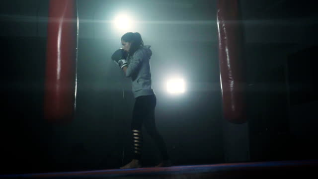energetic woman kickboxing - punch bag stock videos & royalty-free footage