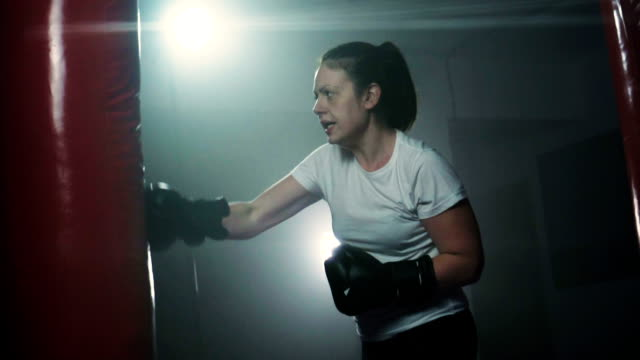 energetic woman kickboxing - cool attitude stock videos and b-roll footage