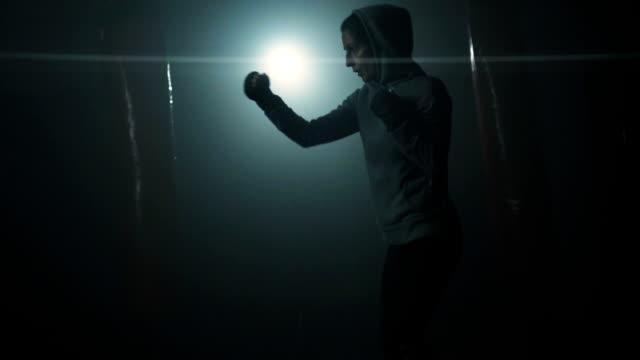 energetic woman shadow boxing - kickboxing stock videos & royalty-free footage