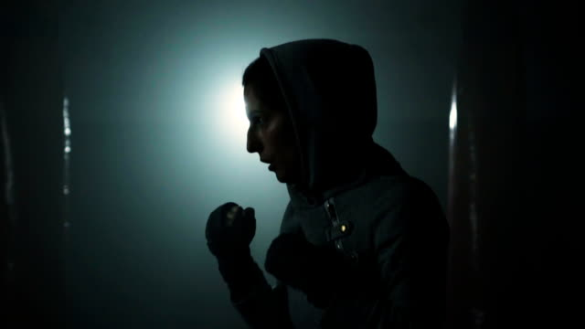 energetic woman shadow boxing - endurance stock videos & royalty-free footage