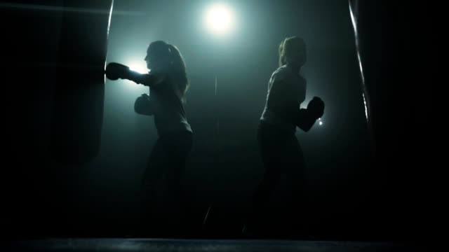 Energetic women kickboxing