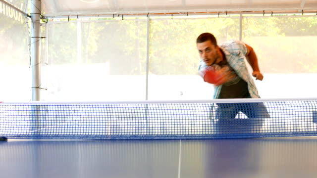energetic young man playing table tennis - table tennis bat stock videos & royalty-free footage