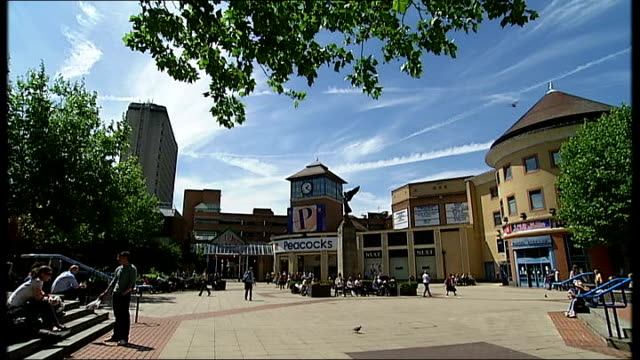 CHP plant carbonneutral hotel shopping centre and streetlighting in Woking General views of shoppers along past carbonneutral shopping centre in...