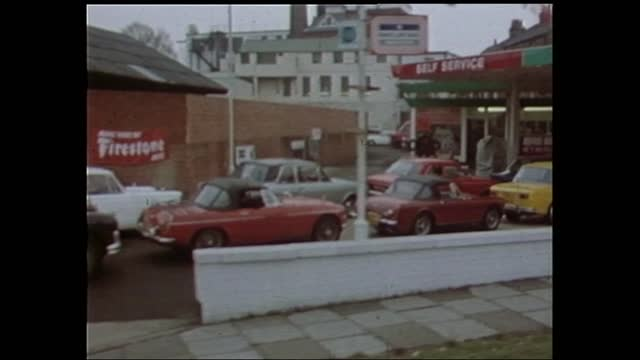 petrol shortage:; b)10pm: cars queue for petrol in south london england: london: ext track past long queue at impact garage l-r fuji 16mm itn 37 secs... - real time stock videos & royalty-free footage