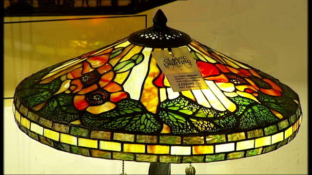 demand for traditional light bulbs soars england kent tunbridge wells int light fittings chandeliers and lights in lighting shop art deco lampshades... - lamp shade stock videos & royalty-free footage