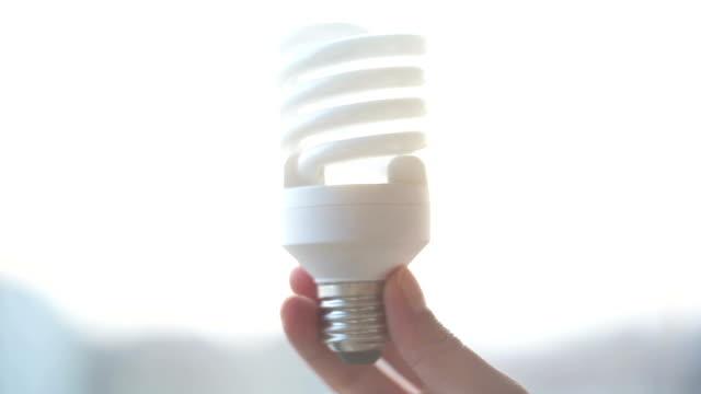 energy efficiency - energy efficient lightbulb stock videos & royalty-free footage