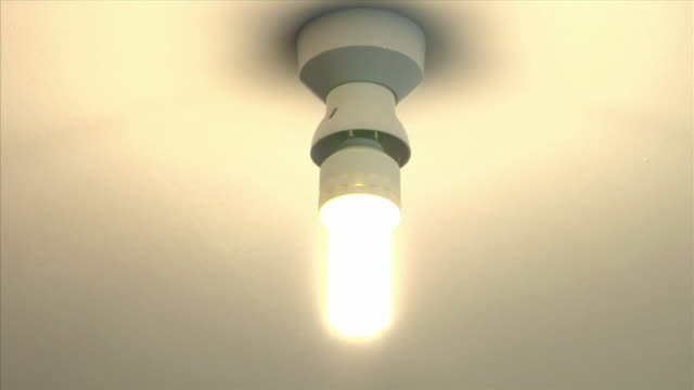 cu, energy efficient light bulb - only mature men stock videos & royalty-free footage