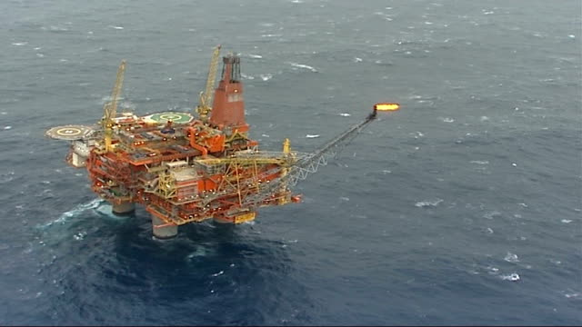 new gas contracts with norway air view oil platform oil platform chimney with flame - norvegia video stock e b–roll
