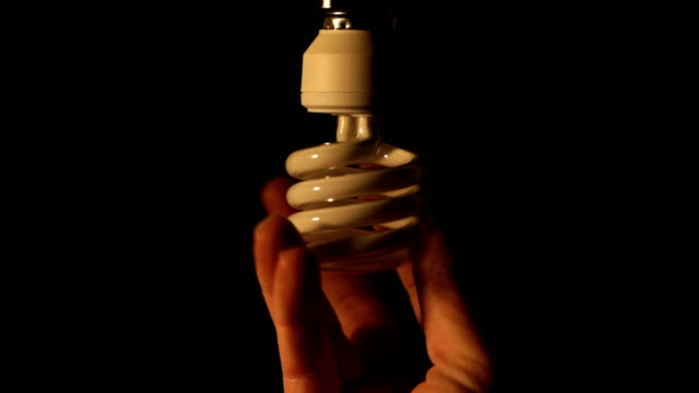 energy saving bulb replacement. - changing lightbulb stock videos & royalty-free footage