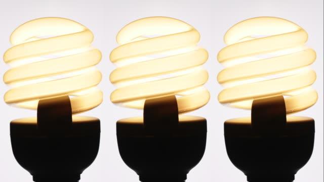 energy saving electric light bulbs. - energy efficient lightbulb stock videos and b-roll footage