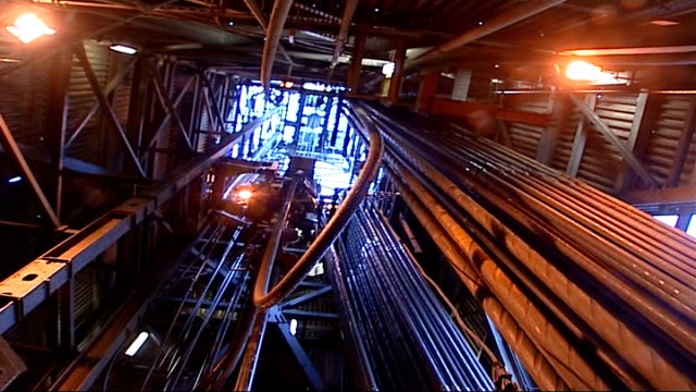 stockvideo's en b-roll-footage met statfjord b oil platform statoil worker in control room and views of hoists pipes and machinery - hijsen