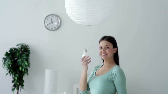 energy-saving bulb - energy efficient lightbulb stock videos and b-roll footage